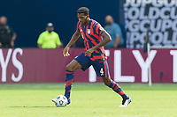 KANSAS CITY, KS - JULY 18: Donovan Pines #4 of the United States moves with the ball during a game between Canada and USMNT at Children's Mercy Park on July 18, 2021 in Kansas City, Kansas.