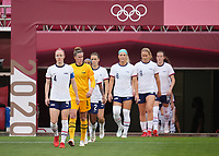 KASHIMA, JAPAN - AUGUST 2: Becky Sauerbrunn #4 of the United States leads her team out to the pitch during a game between Canada and USWNT at Kashima Soccer Stadium on August 2, 2021 in Kashima, Japan.