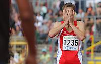 Leichtathletik, Deutsche Meisterschaft vom 25. bis 27.07.2014 im Donaustadion Ulm und auf dem Münsterplatz. Im Bild: Felix Franz (LG Neckar-Enz) kann seinen Sieg über 400 Meter Hürden noch gar nicht fassen.
