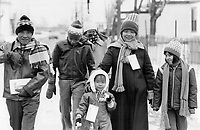 The Bay Ong family walking from mess hall at the Longue Pointem ilitary base, Quebec province