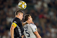 CARSON, CA - SEPTEMBER 15: Daniel Steres #5 of the Los Angeles Galaxy and Matt Besler #5 of Sporting Kansas City battle for a loose ball during a game between Sporting Kansas City and Los Angeles Galaxy at Dignity Health Sports Park on September 15, 2019 in Carson, California.