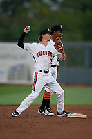 Aberdeen IronBirds shortstop Clay Fisher (19) throws to first base as second baseman Jean Carmona (24) looks on during a NY-Penn League game against the Vermont Lake Monsters on August 19, 2019 at Leidos Field at Ripken Stadium in Aberdeen, Maryland.  Aberdeen defeated Vermont 6-2.  (Mike Janes/Four Seam Images)