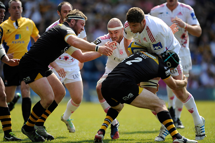 Pascal Pape of Stade Francais runs into Chris Bell of London Wasps during the first leg of the European Rugby Champions Cup play-off match between London Wasps and Stade Francais at Adams Park on Sunday 18th May 2014 (Photo by Rob Munro)