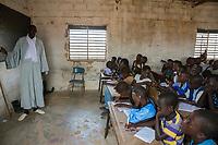 Senegal, Touba.  Teacher Lecturing in Arabic to Students at Al-Azhar Madrasa, a School for Islamic Studies.