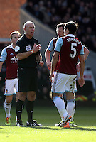 Pictured: Match referee Howard Webb has a stern word with James Tomkins West Ham for a foul against Nathan Dyer of Swansea. 01 February 2014<br /> Re: Barclay's Premier League, West Ham United v Swansea City FC at Boleyn Ground, London.