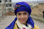 26/2/2015--Kobane.Syria-- A portrait of Zahida (11) year old girl from kobane preparing herself to celebrate the first day of Kurdish year (Newroz eid)