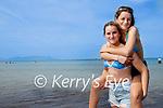Twins Anna and Maria Draghici enjoying the sunshine at Banna Beach on Wednesday.