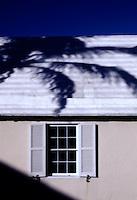 Palm tree shadow on carribean house.