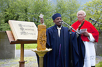 Switzerland. Canton Valais. St-Maurice. Africa Saints Pilgrimage (Pèlerinage aux Saints d'Afrique). A catholic priest and an orthodox priest  are celebrating and praying together during a religious ceremony. The first part of the pilgrimage takes place in Véroliez which is a part of  the town of St-Maurice. 2.06.13 © 2013 Didier Ruef