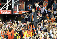 Virginia head coach Tony Bennett holds up the net to celebrate winning the ACC title after defeating Syracuse 75-56 Saturday March 1, 2014 during an NCAA basketball game in Charlottesville, VA.