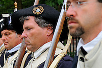 Soldiers of the 6th Connecticut Regiment stand to attention during a July Fourth ceremony to recognize fallen patriots of the Revolutionary War, Grove Street Cemetery, New Haven, Connecticut, USA.