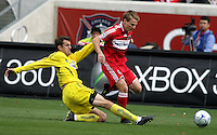 Columbus Crew midfielder Eric Brunner (23) slide tackles the ball away from Chicago Fire midfielder Chris Rolfe (17).  The Columbus Crew tied the Chicago Fire 2-2 at Toyota Park in Bridgeview, IL on September 20, 2009.
