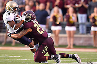Texas State cornerback Craig Mager (25) brings down Navy's Geoffrey Whiteside (29) during NCAA Football game, Saturday, September 13, 2014 in San Marcos, Tex. Navy leads Texas State 28-7 at the halftime.(Mo Khursheed/TFV Media via AP Images)