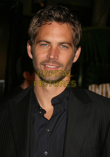 """30 November 2013 - Santa Clarita, California - Paul Walker died at the age of 40 in a car accident while attending a charity event for his organization Reach Out Worldwide. The accident occurred in Santa Clarita when Walker's Porsche lost control and crashed into a tree. The car burst into flames and exploded. File Photo: 12 March 2009 - Universal City, CA - Paul Walker. """"Fast & Furious"""" Los Angeles Premiere at the Universal City Walk Gibson Amphitheatre.<br /> CAP/ADM/MJ<br /> ©Michael Jade/AdMedia/Capital Pictures"""