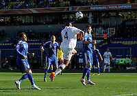 Winston Reid of New Zealand scores a last minute equalising goal