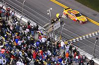 Feb 07, 2009; Daytona Beach, FL, USA; NASCAR Sprint Cup Series driver Kevin Harvick takes the checkered flag to win the Bud Shootout at Daytona International Speedway. Mandatory Credit: Mark J. Rebilas-