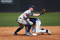 Joe Butts (10) of the Catawba Indians shows the ball to the umpire after Riley Cheek (3) of the Queens Royals steals second base during game two of a double-header at Tuckaseegee Dream Fields on March 26, 2021 in Kannapolis, North Carolina. (Brian Westerholt/Four Seam Images)