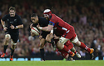 Wales lock Jake Ball tackles All Blacks scrum half Aaron Smith.<br /> Dove men Series 2014<br /> Wales v New Zealand<br /> 22.11.14<br /> ©Steve Pope -SPORTINGWALES