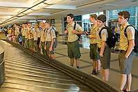 Photo story of Philmont Scout Ranch in Cimarron, New Mexico, taken during a Boy Scout Troop backpack trip in the summer of 2013. Photo is part of a comprehensive picture package which shows in-depth photography of a BSA Ventures crew on a trek. In this photo,  A Boy Scout venture crew waits on their luggage at Denver International airport, before catching a charter bus to  venture crew Philmont Scout Ranch, Cimarron, New Mexico.<br /> <br /> Photo by travel photograph: PatrickschneiderPhoto.com