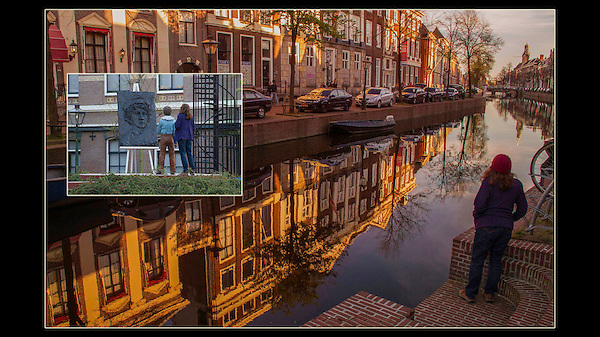 Netherlands, Leiden.  <br /> Step back and be the unobtrusive photographer.  Woman visiting canal in Leiden, Netherlands.