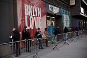 Brooklyn, New York<br /> March 18, 2020<br /> 8:01 AM<br /> <br /> Brooklyn under coronavirus pandemic. <br /> <br /> People eating in-line to enter Trader Joes to buy food. People are hoarding food in fears that the will be a short supply. Some wear face masks fearing the spread of the virus.
