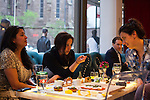 Izzy Katz (right), Laura Trevino (center), and Shana Pederson (left), enjoy food and music at Toshi's Living Room, located on the bottom floor of the Flatiron Hotel, located at 1141 Broadway, New York, NY...There is a restaurant/bar boom happening on 26th Street between Broadway and 7th Avenue in Manhattan. About six new places have opened up in the last 8 months. This area of development is called NoMad (north of Madison Sq. Park)...Photographed on 4/23/13 by Mark Abramson for The Wall Street Journal.