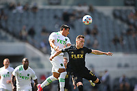 LOS ANGELES, CA - APRIL 17: Nick Lima #24 of Austin FC and Corey Baird #13 of battle for a ball during a game between Austin FC and Los Angeles FC at Banc of California Stadium on April 17, 2021 in Los Angeles, California.