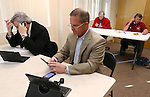 Lt. Governor candidate Sen. Mark Hutchison, R-Las Vegas, works the phones in his campaign office in Reno, Nev., on Tuesday, Nov. 4, 2014. (AP Photo/Cathleen Allison)