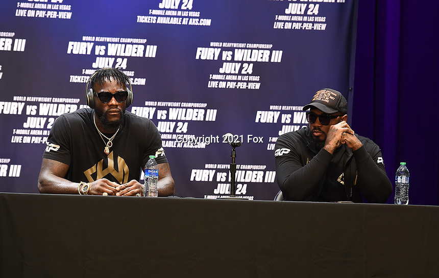"""LOS ANGELES, CA - JUNE 15: (L-R) Deontay Wilder and trainer Malik Scott attend a press conference for the FOX Sports PPV """"Tyson Fury vs. Deontay Wilder III"""" at The Novo by Microsoft at LA Live on June 15, 2021 in Los Angeles, California. Fury vs. Wilder will be on July 24 at the T-Mobile Arena in Las Vegas. (Photo by Frank Micelotta/HULU/PictureGroup)"""