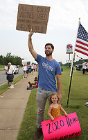 """Dr. Jeffrey Alliston, a urologist at Mercy Hospital, holds a sign, Sunday, August 1, 2021 during a March for Mercy rally along the sidewalk of South Promenade Blvd. in Rogers. """"Theres a hard stop for me participating in any medication or product that Is directly linked to an aborted fetal cell culture,"""" he said for for why he has chosen not to take the covid-19 vaccine. He believes all three vaccines contain aborted fetal cells. He said he is in the process of applying for a religious exemption from having to take the vaccine. """"If they deny it, I'm not going to budge on my convictions just to keep a job,"""" he said. Hundreds came out to protest the covid-19 vaccine mandate for Mercy Hospital employees. Mercy will require all workers to be vaccinated by September 30.  Check out nwaonline.com/210802Daily/ for today's photo gallery. <br /> (NWA Democrat-Gazette/Charlie Kaijo)"""