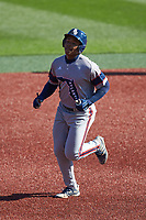 B.J. Murray (9) of the Florida Atlantic Owls rounds the bases after hitting a home run against the Charlotte 49ers at Hayes Stadium on April 2, 2021 in Charlotte, North Carolina. The 49ers defeated the Owls 9-5. (Brian Westerholt/Four Seam Images)