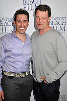 """PAUL J. ALESSI, producer/actor & JOHN NOBLE.""""Knuckle Draggers"""" Premiere at the 2009 Newport Beach Film Festival held at Edwards Cinemas, Newport Beach, CA, USA..April 27th, 2009.half length purple shirt top hand in pocket grey gray .CAP/ADM/BP.©Byron Purvis/AdMedia/Capital Pictures."""