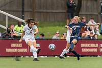 NEWTON, MA - AUGUST 29: Jessica Carlton #32 of Boston College passes the ball as Chloe Landers #2 of University of Connecticut defends during a game between University of Connecticut and Boston College at Newton Campus Soccer Field on August 29, 2021 in Newton, Massachusetts.