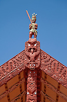 Tekoteko (carved male figure) of Chief Tematekapua, captain of the Te Arawa canoe which arrived in New Zealand (Aotearoa) in 1350.  Maori Marae (Meeting House), Ohinemutu Village, Rotorua, north island, New Zealand.  Rebuilt 1942-43.