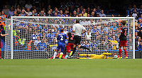 Pictured: Lukasz Fabianski of Swansea (in yellow) saves the ball from a Chelsea shot. Saturday 13 September 2014<br /> Re: Premier League Chelsea FC v Swansea City FC at Stamford Bridge, London, UK.