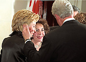 First lady Hillary Rodham Clinton, left, and United States President Bill Clinton, right, greet actress Elizabeth Taylor, center, in the receiving line at the Creator' Dinner at the White House in Washington, D.C. on December 31, 1999. <br /> Credit: Ron Sachs / CNP