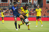 HOUSTON, TX - JUNE 13: Catarina Macario #11 of the United States battles with Vyan Sampson #4 of Jamaica during a game between Jamaica and USWNT at BBVA Stadium on June 13, 2021 in Houston, Texas.