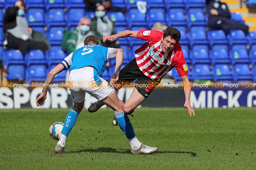 Sunderland's Ross Stewart goes over Peterborough United's Mark Beevers during Peterborough United vs Sunderland AFC, Sky Bet EFL League 1 Football at London Road on 5th April 2021