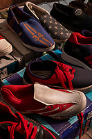 Slip-on shoes are seen for sale in the street market on Meena Bazar in the Chadni Chowk area of Delhi, India, on Tue., Dec. 11, 2018.