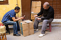 Fes, Morocco.  Men Playing Cards in a Street in the Medina.