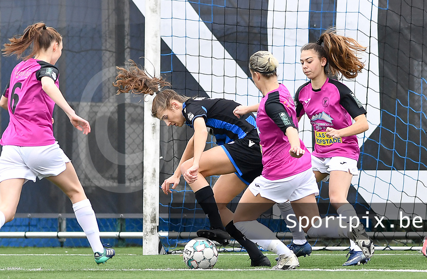 Marie Minnaert (13 Brugge) pictured in a duel with Aalst's Tiffanie Vanderdonckt and Aalst's Stephanie Van Gils during a female soccer game between Club Brugge Dames YLA and Eendracht Aalst Ladies on the 9 th matchday of the 2020 - 2021 season of Belgian Scooore Womens Super League , saturday 12 December 2020  in Brugge , Belgium . PHOTO SPORTPIX.BE | SPP | DAVID CATRY