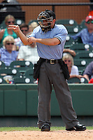 Home plate umpire Ramon Hernandez makes a call during a game between the Daytona Cubs and Lakeland Flying Tigers at Joker Marchant Stadium on April 29, 2012 in Lakeland, Florida.  Lakeland defeated Daytona 6-4.  (Mike Janes/Four Seam Images)