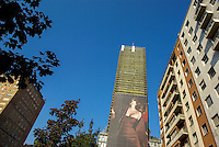 "Milano, piazza della Repubblica. Cartellone pubblicitario con l'immagine di una donna sul grattacielo ""Torre Breda"" --- Milan, Repubblica square. A Billboard with the image of a woman on the skyscraper ""Breda Tower"""