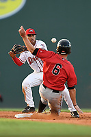 Center fielder Luis Gonzalez (6) of the Kannapolis Intimidators is safe at second as Santiago Espinal (2) of the Greenville Drive takes a late throw in a game on Wednesday, July 12, 2017, at Fluor Field at the West End in Greenville, South Carolina. Greenville won, 12-2. (Tom Priddy/Four Seam Images)
