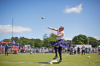 Neil Elliott competes in a putting ball competition at the Helensburgh and Lomond Highland Games in Argyll. Neil competes in over 40 heavyweight events across the world throughout the summer.