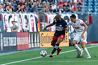 FOXBOROUGH, MA - JUNE 23: Andrew Farrell #2 of New England Revolution controls the ball as Sean Davis #27 of New York Red Bulls closes during a game between New York Red Bulls and New England Revolution at Gillette Stadium on June 23, 2021 in Foxborough, Massachusetts.