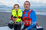 Little Grace Usher helping her dad Ciaran on the beach in Ballyheigue before their swim on Saturday morning.