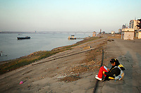 CHINA. Jiangxi Province.  Jiujiang. A scoolchild writes in her diary on the banks of the Yangtze River. Jiujiang is a city of 4.6 million people, located on the southern shore of the Yangtze River. The Yangtze River is reported to be at its lowest level in 150 years as a result of a country-wide drought. It is China's longest river and the third longest in the world. Originating in Tibet, the river flows for 3,964 miles (6,380km) through central China into the East China Sea at Shanghai.  2008