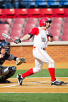 Keith Hernandez #10 of the Delaware State Hornets follows through on his swing against the Georgetown Hoyas at Gene Hooks Field on February 26, 2011 in Winston-Salem, North Carolina.  Photo by Brian Westerholt / Four Seam Images