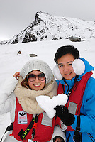 "photograph by XAVIER CERVERA 06/2010.a chinese couple, in a romantic trip feeling, show very pround their sweet heart made by ice in Ytre Norskøya Hills, northwestern Spitsbergen island, Svalbard archipielago; on the ""evening landing"" (usually two per day) from norwegian vessel (made in Italy) MS Fram"